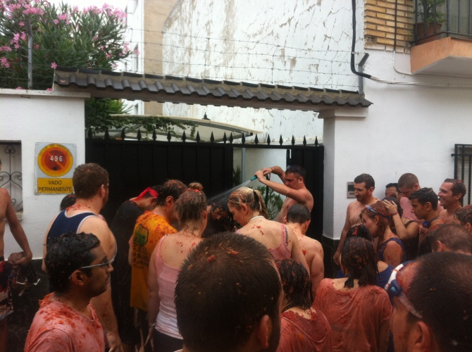 Locals washing off some participants with a hose.